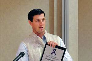 Greenwich High School football coach John Marinelli received the Purple Ribbon Award for his work towards eradicating domestic abuse during the YWCA of Greenwich Domestic Abuse Services annual Candlelight Vigil to honor the victims of domestic abuse at the YWCA of Greenwich in 2017.