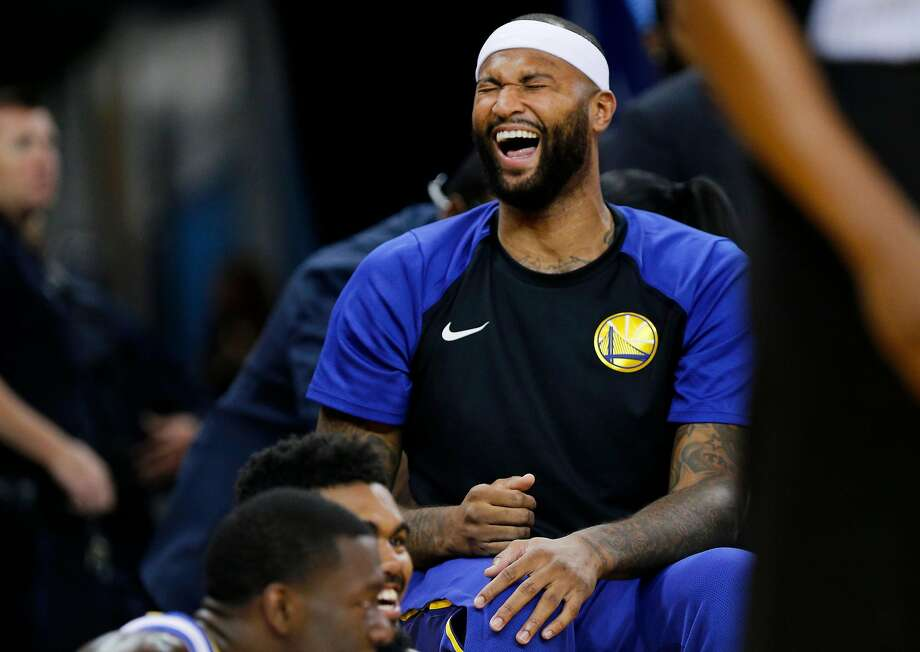 Golden State Warriors center DeMarcus Cousins (0) has a laugh with his teammates on the bench during the second half of an NBA preseason game between the Golden State Warriors and Minnesota Timberwolves at Oracle Arena on Saturday, Sept. 29, 2018, in Oakland, Calif. The Minnesota Timberwolves won 114-110. Photo: Santiago Mejia / The Chronicle