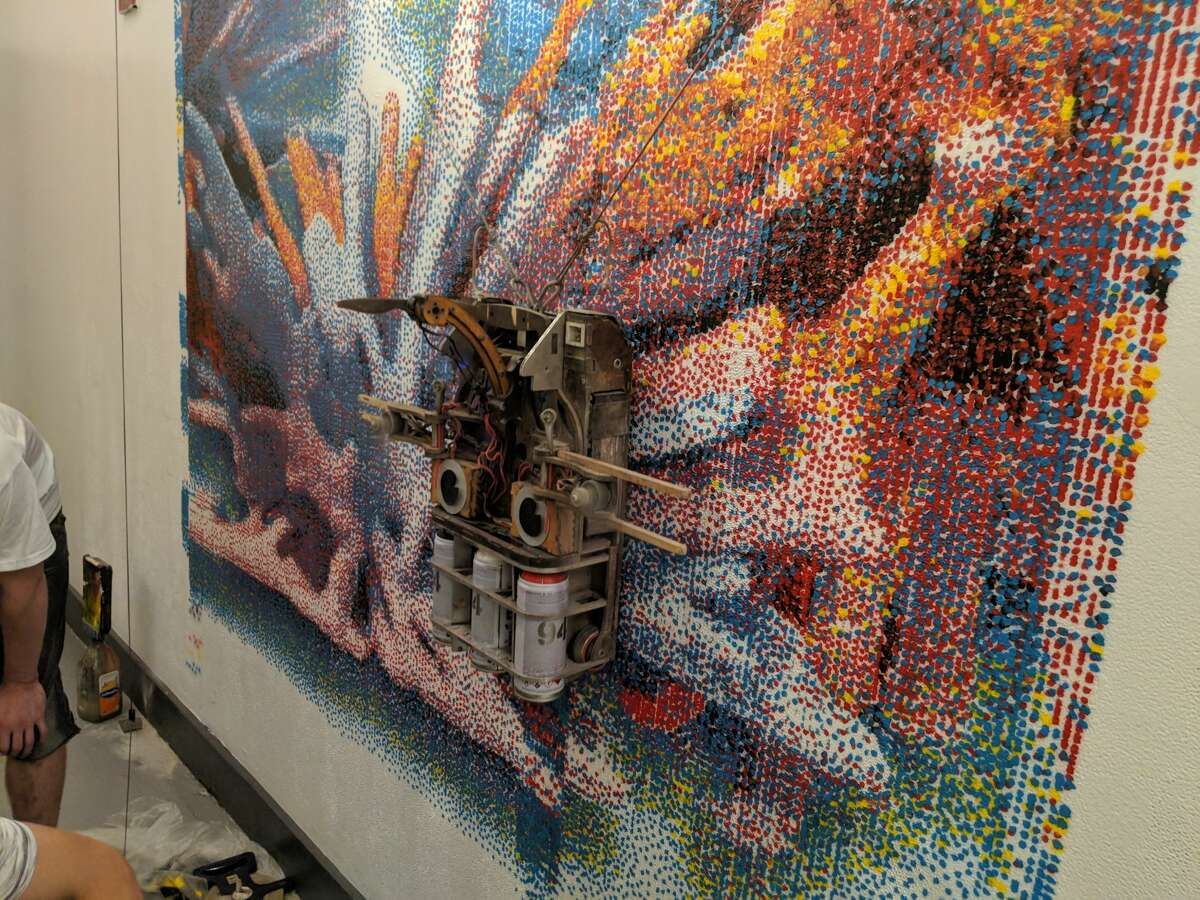 Albert the mural painting robot paints a test print of a digital image designed after brainwave data on human communication.