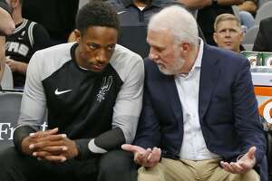 DeMar DeRozan #10 of the San Antonio Spurs talks with head coach Gregg Popovich before the start of the game. Detroit Pistons v San Antonio Spurs at the AT&T Center on Friday, October 5, 2018.
