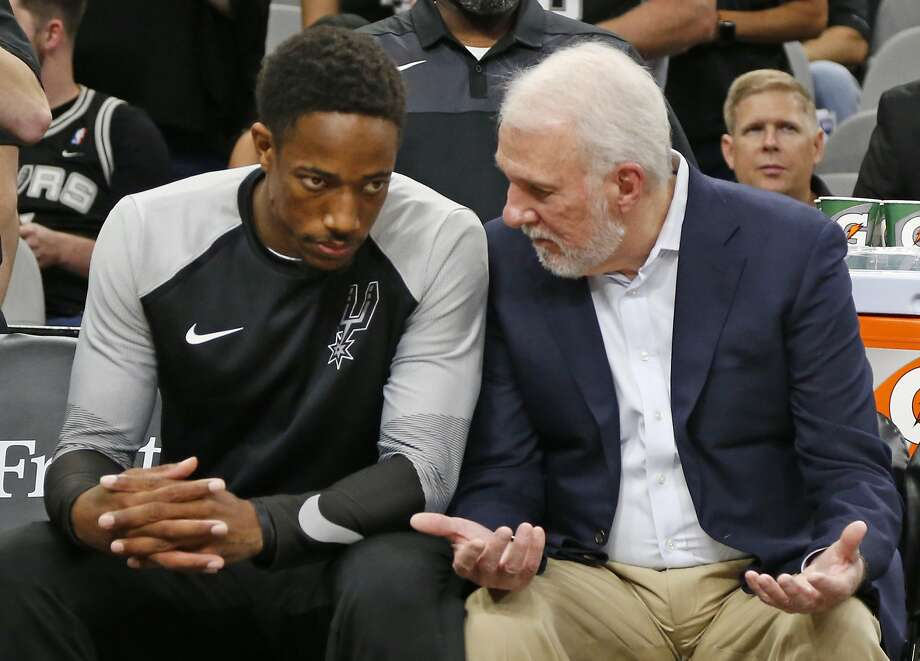 DeMar DeRozan #10 of the San Antonio Spurs talks with head coach Gregg Popovich before the start of the game. Detroit Pistons v San Antonio Spurs at the AT&T Center on Friday, October 5, 2018. Photo: Ronald Cortes/Correspondent
