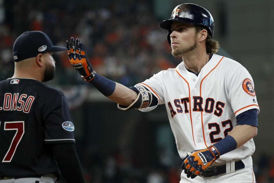 Houston Astros outfielder Josh Reddick (22) hits a single in the third inning of Game 2 of the American League Division Series at Minute Maid Park on Saturday, Oct. 6, 2018, in Houston.