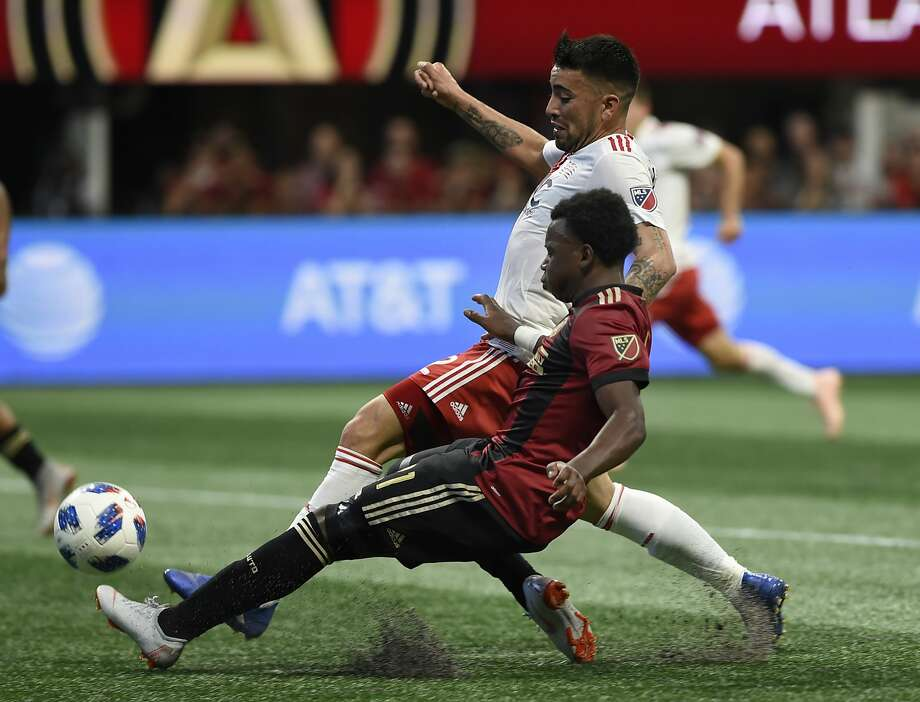 Atlanta United defender George Bello, 16, works for the ball against New England Revolution forward Guillermo Hauche. Photo: Annie Rice / Associated Press