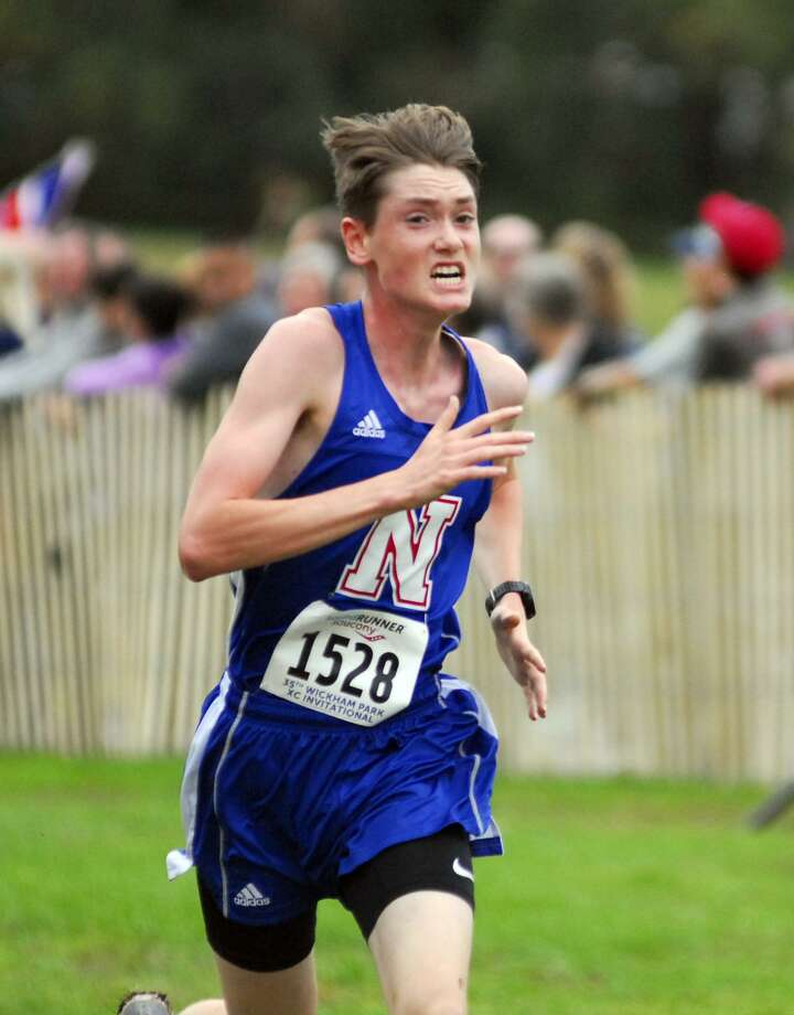 Nonnewaug's Eddie Nicholas wins the boys seeded race at the Wickham Invitational on Saturday. Photo: Ryan Lacey /Hearst Connecticut Media
