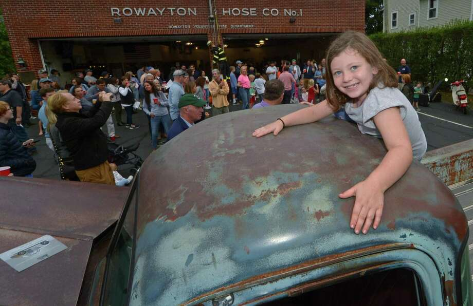 Annabel Frank, 6, of Rowayton climbs on top of an antique pick-up truck from Black Ridge Motors during the Rowayton Fire Department annual fundraiser Saturday, October 6, 2018, at the firehouse in Norwalk, Conn. Rowaytons Best BBQers featured their smoked specialties and fire trucks were displayed for the junior firefighters. Photo: Erik Trautmann / Hearst Connecticut Media / Norwalk Hour