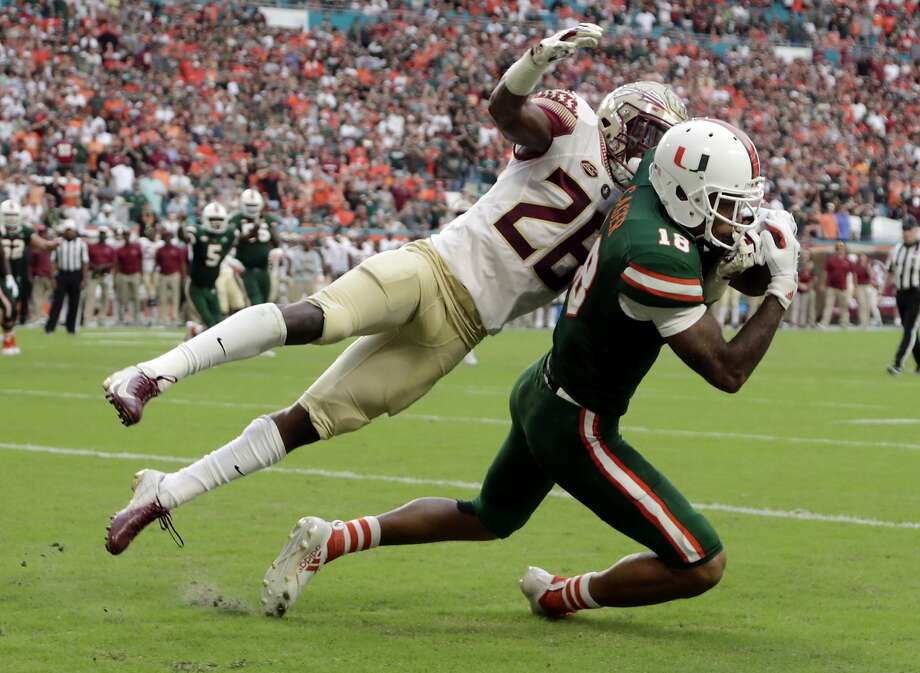 Miami wide receiver Lawrence Cager scores past Florida State defensive back Asante Samuel Jr. Photo: Lynne Sladky / Associated Press