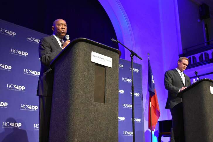 """Mayor Sylvester Turner and Houston Professional Fire Firefighters Association President Marty Lancton debated Proposition B, theNovember ballot referendum that would grant firefighters pay """"parity"""" with police officers of corresponding rank and seniority, atSt. John's United Methodist Churchon Saturday, Oct. 6, 2018."""