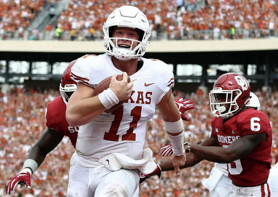 Seeing the end zone ahead brings a smile to Sam Ehlinger's face Saturday. The UT quarterback ran for three touchdowns and passed for two more against Oklahoma. Photo: Ronald Martinez, Staff / Getty Images / 2018 Getty Images