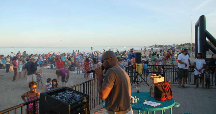 "Marvin J. Parson - ""DJ Vizunari"" - served as the musical entertainment during the Town of Fairfield's Sand Jam at Jennings Beach on July 2. Photo: Gary Jeanfaivre / Fairfield Citizen"