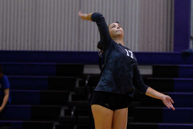 Midland Classical's Jenny Coco hits against Lake Country Christian Oct. 6, 2018, at MCA. James Durbin/Reporter-Telegram