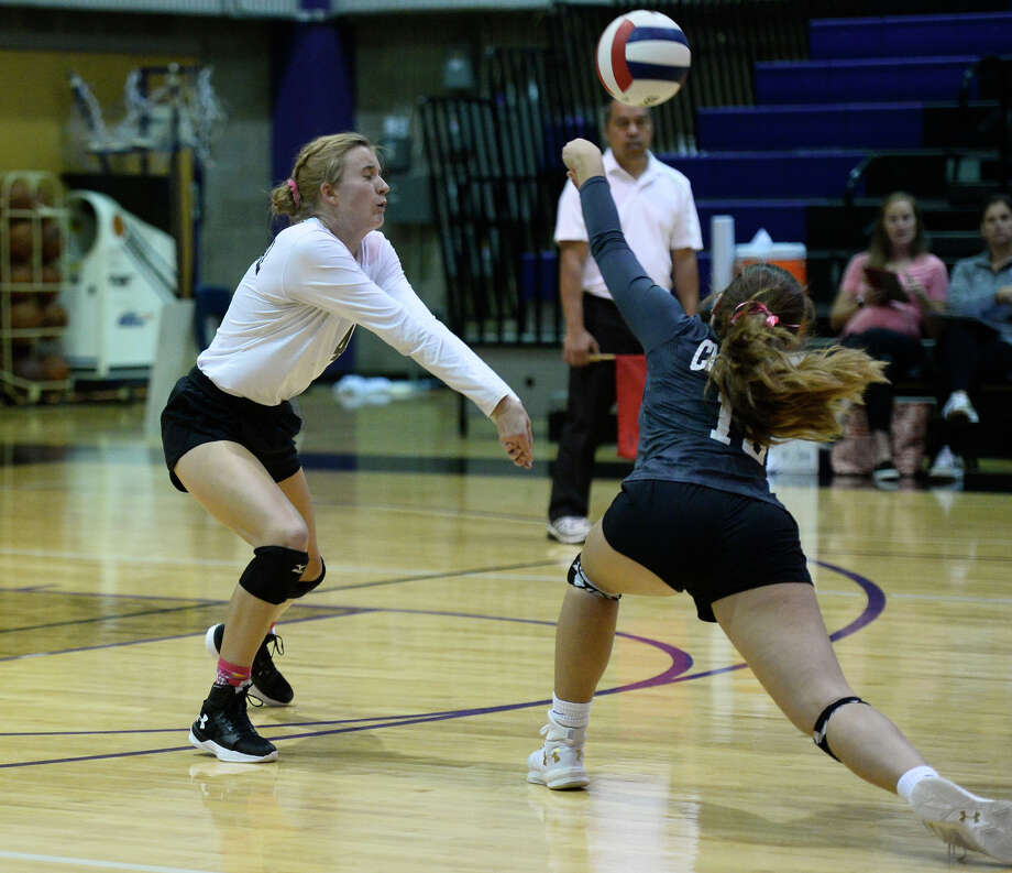 Midland Classical's Kacy Miller (4) and Grace Coco (16) attempt to keep the ball in play against Lake Country Christian Oct. 6, 2018, at MCA. James Durbin/Reporter-Telegram Photo: James Durbin / ? 2018 Midland Reporter-Telegram. All Rights Reserved.