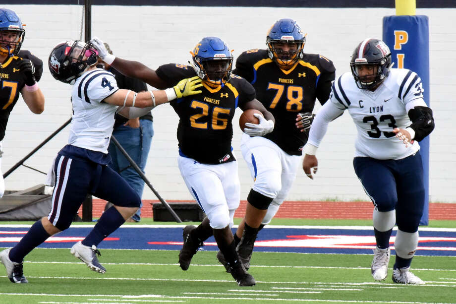 PUSH OFF  Wayland Baptist sophomore running back Jacoby Hunt (26) denies Lyon College senior safety Stephene Benedik (left) with a stiff arm during the Pioneers' Sooner Athletic Conference football game against the Scots on Saturday at Greg Sherwood Memorial Stadium in Plainview. The Pioneers' Darian Flores and the Scots' Peter Tuipulotu trail the play. Photo: Claudia Lusk/Wayland Baptist University