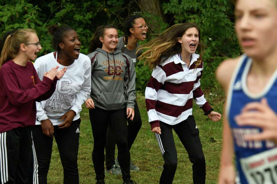 Colonie girls cross-country runners cheer on their teammates during a race at the 80th Annual Grout Run event on Saturday, Oct. 6, 2018, in Schenectady, N.Y. (Jenn March, Special to the Times Union) Photo: Jenn March / © Jenn March 2018 © Albany Times Union 2018