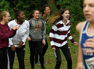 Colonie girls cross-country runners cheer on their teammates during a race at the 80th Annual Grout Run event on Saturday, Oct. 6, 2018, in Schenectady, N.Y. (Jenn March, Special to the Times Union)