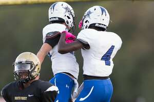La'Darrin Thomas (4) of the Navasota Rattlers celebrates his touchdown in the first half with a teammate against the North Forest Bulldogs in a high school football game on Saturday, October 6, 2018 at Jones Cowart Stadium in Houston Texas.