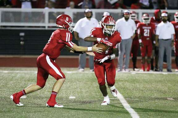 Crosby quarterback Kobe Coker hands off the ball to running back Noel Wright II in the backfield for a large gain during the Cougar win over rivals Dayton.