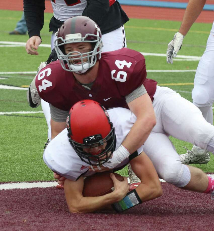 Glens Falls' Griffen Woodell dives for a touchdown under pressure from BHBL's Grant Schaffer during the non-league football matchup at Burnt Hills-Ballston Lake High School Saturday, Oct. 6, 2018. (Ed Burke photo-Special to The Time Union)