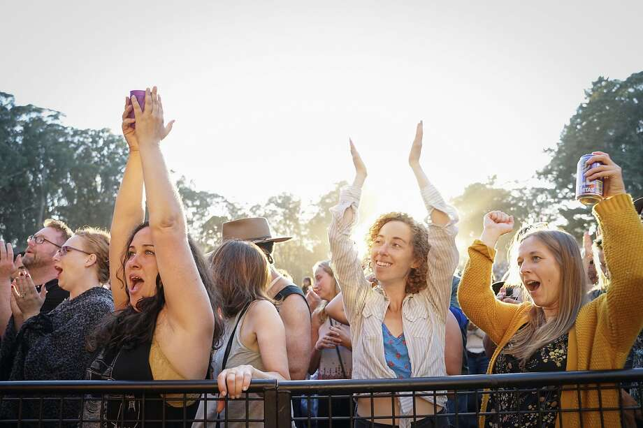 (Left to right) Dorothy Bedecarre, Sam Stone and Makenzi Rasey of Buffalo, cheer during Ani DiFranco�s performance at Hardly Strictly Bluegrass music festival at Golden Gate Park in San Francisco, Calif. on Saturday, October 6, 2018. Photo: Sarahbeth Maney, SFC