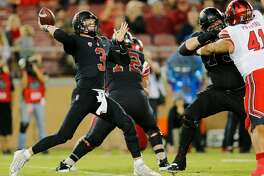 Stanford Cardinal quarterback K.J. Costello (3) throws deep for an incomplete pass in the second quarter of an NCAA football game between the Stanford Cardinal and the Utah Utes at Stanford Stadium on Saturday, Oct. 6, 2018, in Stanford, Calif.