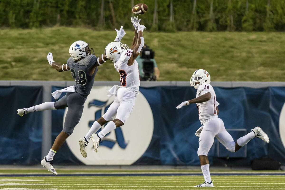 UTSA defensive back Cassius Grady tips a pass intended for Rice receiver Aaron Cephus. Grady hauled it in for an interception, returning it to the Rice 3 to set up a B.J. Daniels touchdown run.