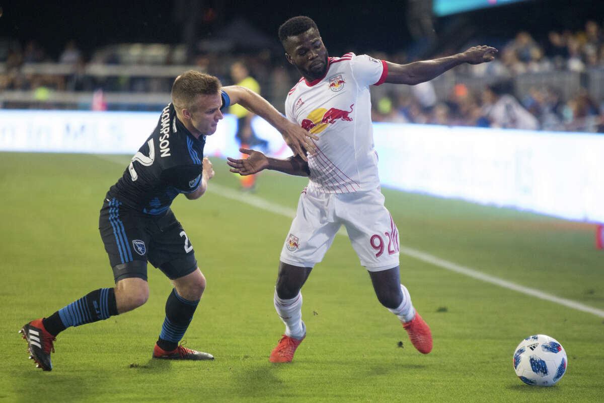 The Red Bulls Kemar Lawrence is defended by the Earthquakes Tommy Thompson. The New York Red Bulls defeated the San Jose Earthquakes 3-1 at Avaya Stadium on October 6, 2018.