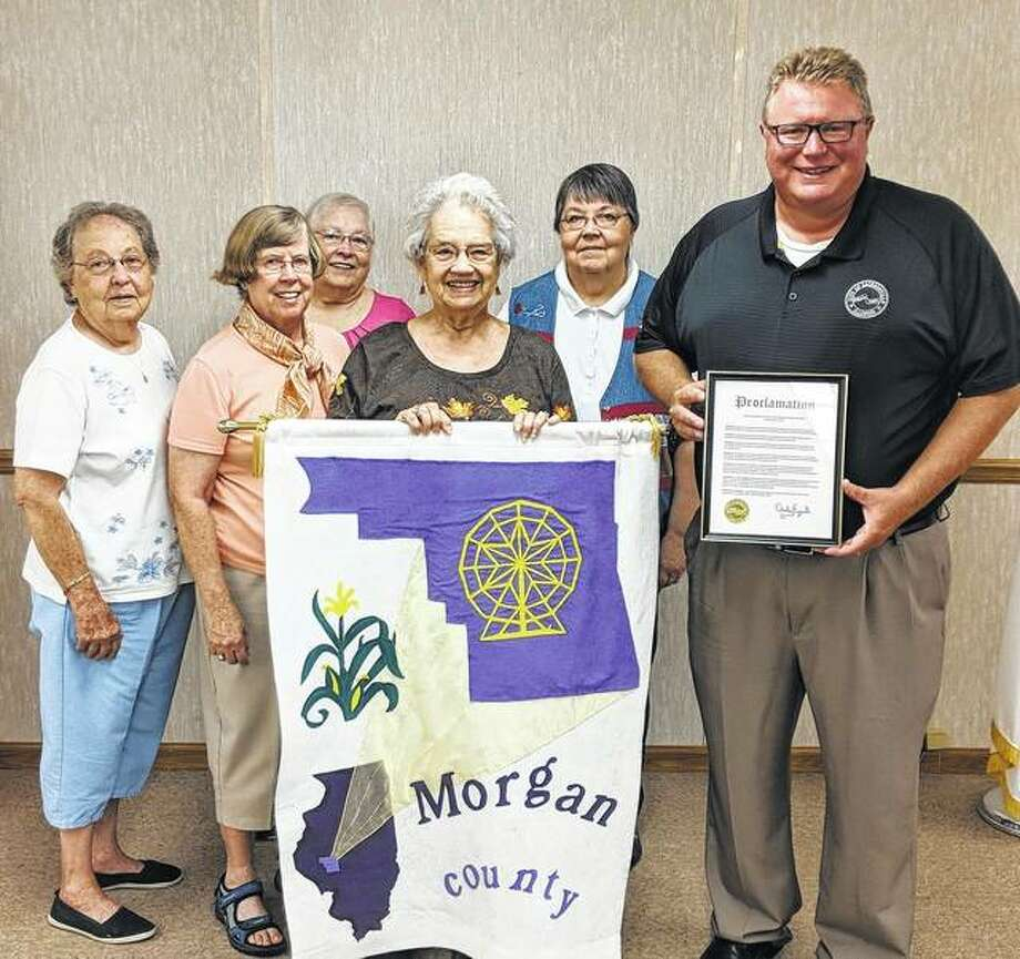 Mayor Andy Ezard (right) proclaims Monday through Oct. 14 as Illinois Association for Home and Community Education (IAHCE) Week in Jacksonville. On hand for the proclamation were Morgan County HCE Board members Nada King (from left), Martha Vache, Linda Settles, Sharon Middendorf and Anita Ashcroft. Board members not pictured are Barb Baptist and Barbara Collins. Photo: Photo Provided