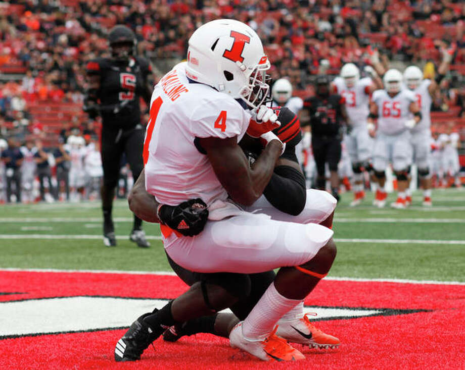Illinois WR Rick Smalling (4) hauls in a touchdown pass as Rutgers' Avery Young defends Saturday in Piscataway, N.J. Photo: Associated Press