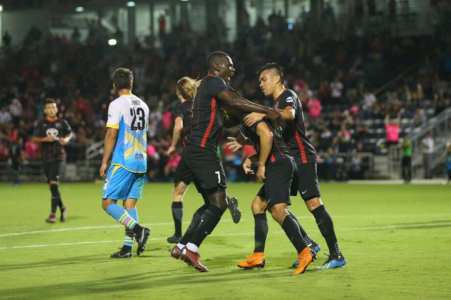 San Antonio FC's Lance Laing (left) and Jose Escalante celebrate with Ever Guzman after Guzman scored one of his two goals in Saturday's 3-1 win over Las Vegas Lights FC. Photo: Josh Jordan /USL / ©2018 Josh Jordan/USL