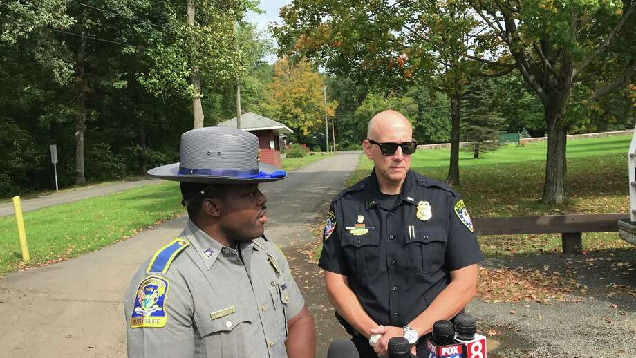 Connecticut StateTrooper Josue Dorelus and Lt. Fred Jortner from Cheshire Police answer reporters question Thursday about a dead body found near Mixville Road. The dead person was later identified as Cheshire High School Engilish Department Head Megumi Yamamoto. Photo: Luther Turmelle/Heart Media Connecticut