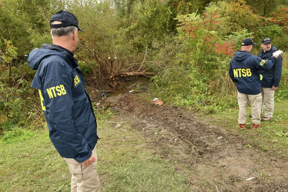 Members of the NTSB survey the scene of an accident that happened next to the Apple Barrel Cafe at Rt. 30 at Rt. 30A Saturday afternoon involving a limo carrying a party on Sunday, Oct. 7, 2018 in Schoharie, N.Y. 20 people are reported to have died in the accident. (Lori Van Buren/Times Union)