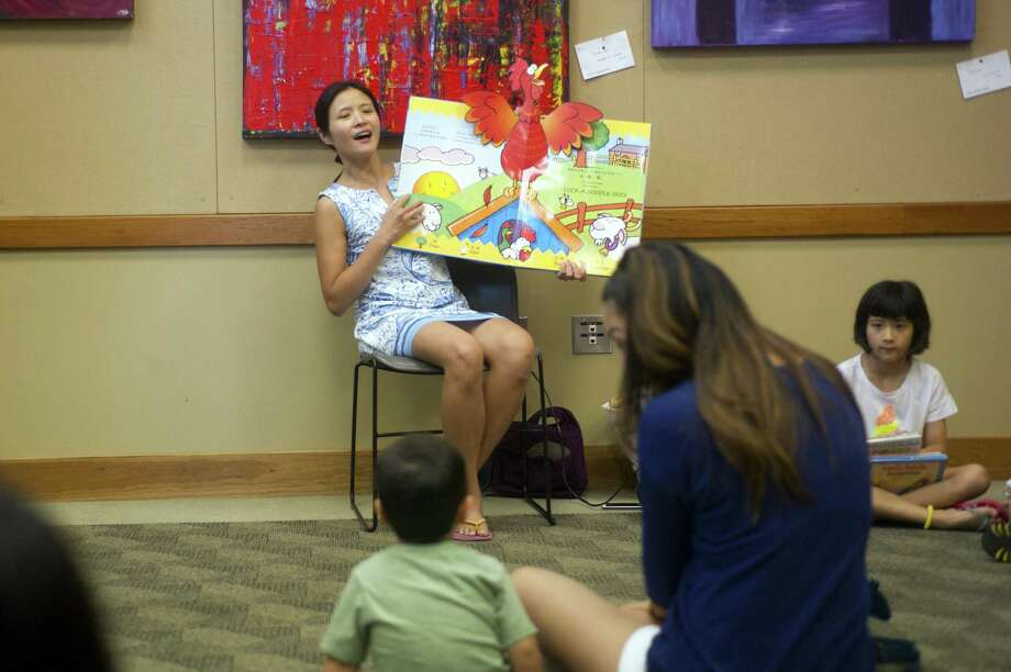Irene Ng reads a book in Mandarin while leading a free children's story time inside the Cos Cob Library in Greenwich. Mandarin Storytime is held weekly from 11:15 to 11:45 a.m. Tuesdays in the Community Room. Free. No registration required. Photo: File / Michael Cummo / Hearst Connecticut Media / Stamford Advocate