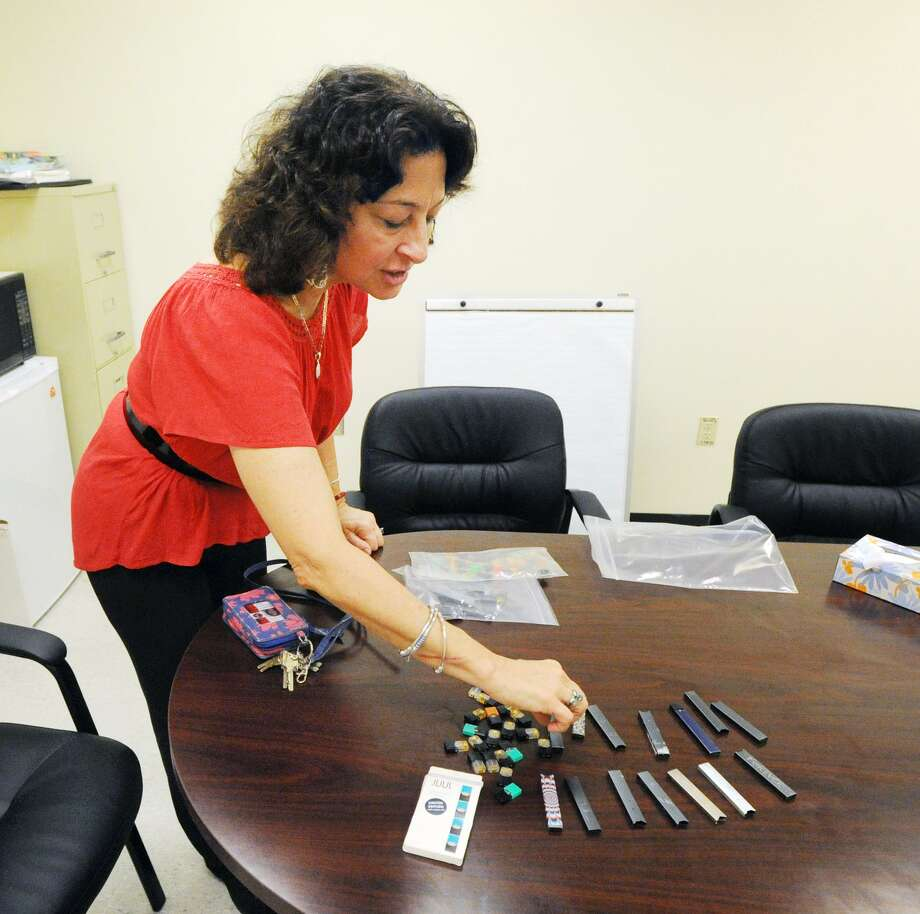 Lorraine Termini, dean of Student Life at Greenwich High School, displays confiscated vaping devices at the school in Greenwich, Conn., Friday, Oct. 5, 2018. Vaping is the act of inhaling and exhaling aerosol vapor produced by an e-cigarette or similar electronic device. Photo: Bob Luckey Jr. / Hearst Connecticut Media / Greenwich Time