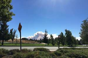 A plume of smoke from a brush�fire�near Fairfield that went up amid high winds on Oct. 7, 2018