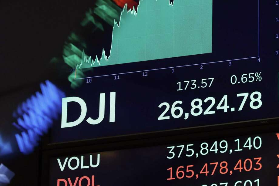 A board above the floor of the New York Stock Exchange shows the Dow Jones industrial average at it reaches 26,824.78 during intraday trading, Tuesday, Oct. 2, 2018. Photo: Richard Drew, STF / Associated Press / Copyright 2018 The Associated Press. All rights reserved