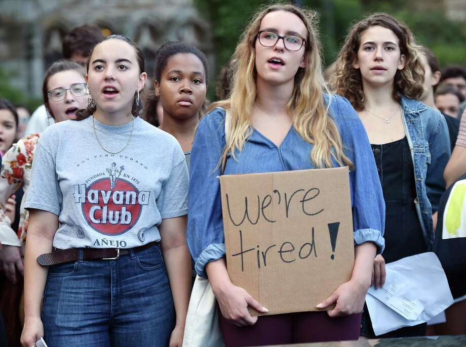 Yale University students gather around the Women's Table, a sculpture which marks the 20th anniversary of women on the New Haven campus Wednesday, September 26, 2018, protesting the nomination of the conservative appellate-court judge Brett Kavanaugh to the Supreme Court due to allegations of misconduct. Kavanaugh graduated from Yale in 1987 with a Bachelor of Arts and Yale Law School in 1990. Photo: Catherine Avalone, Staff Photojournalist | New Haven Register / Hearst Connecticut Media / New Haven Register