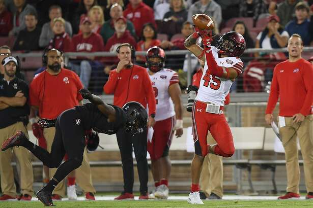 PALO ALTO, CA - OCTOBER 06: Samson Nacua #45 of the Utah Utes catches a 57 yard touchdown pass over Frank Buncom #5 of the Stanford Cardinal during the fourth quarter of their NCAA football game at Stanford Stadium on October 6, 2018 in Palo Alto, California. Utah won the game 40-21. (Photo by Thearon W. Henderson/Getty Images)