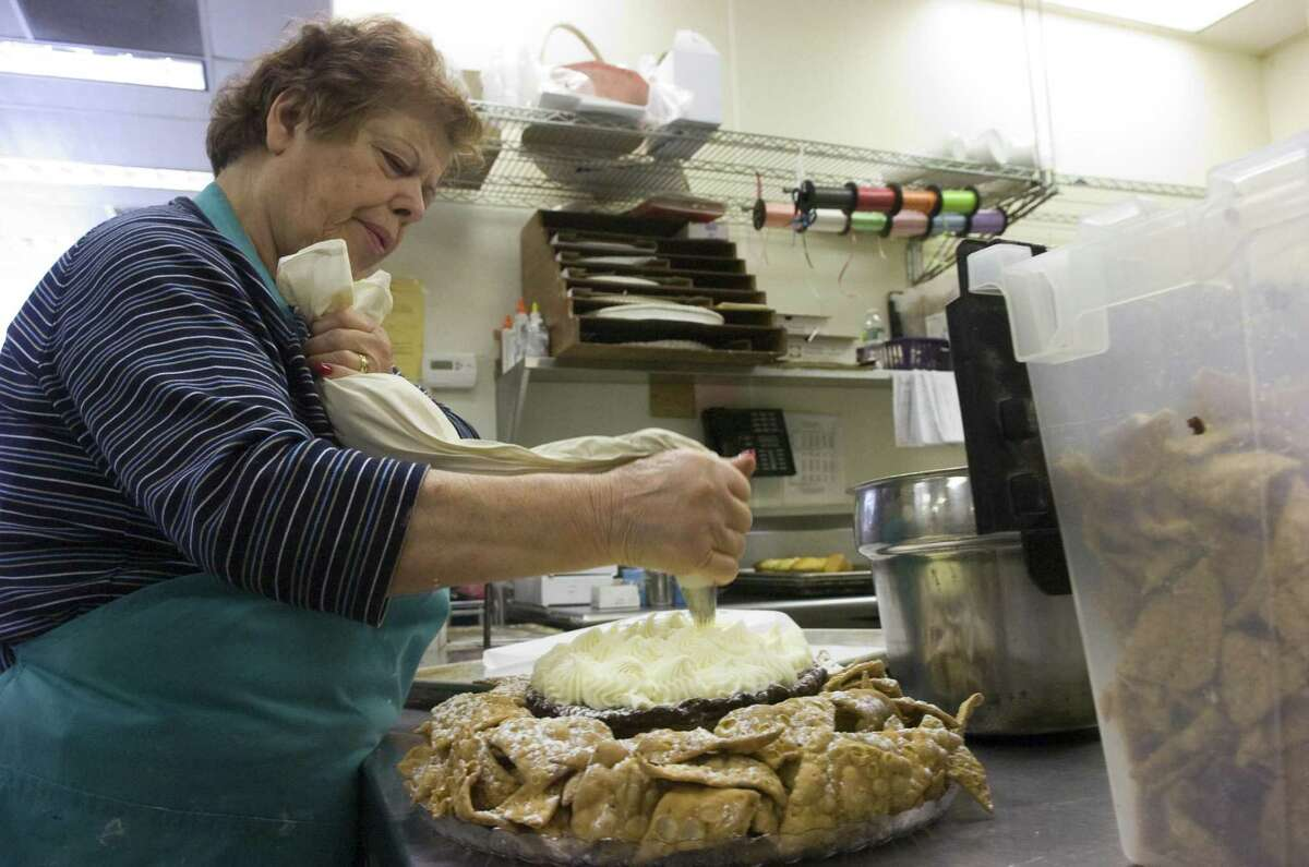 Bice DiMare puts the finishing touch on cannoli nacho dip at DiMare Pastery Shop for the second annual Chocolate, Dessert and Wine Lovers?' Evening in Stamford, Conn., February 8, 2011. The event is held Thursday at the Hilton Stamford Hotel.