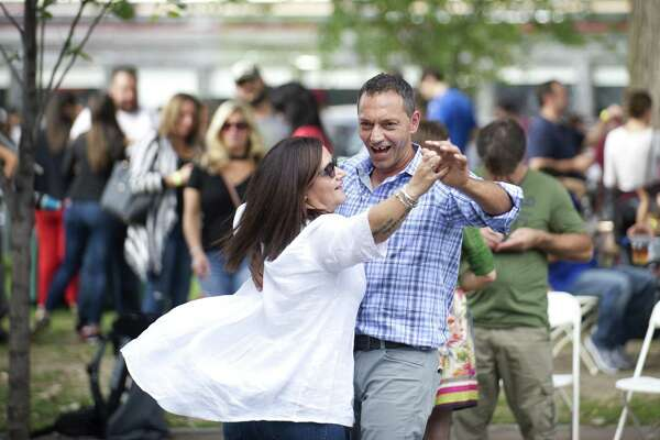 Italians Stegano Arcese and Grazia Radalico dance during the That's Amore Italian Street Festival in downtown Stamford, Conn. on Sunday, Oct. 7, 2018. The inaugural festival celebrated Columbus Day as well as Italian culture and tradition.