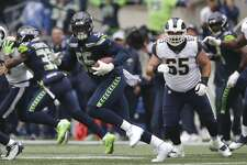 Seattle Seahawks defensive end Frank Clark (55) runs the ball after he intercepted a pass during the first half of an NFL football game against the Los Angeles Rams, Sunday, Oct. 7, 2018, in Seattle. (AP Photo/Scott Eklund)