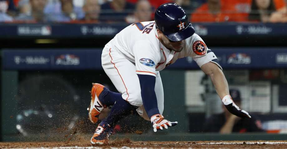 Houston Astros second baseman Jose Altuve (27) trips coming out of the batters box after hitting a single in the sixth inning of Game 2 of the American League Division Series at Minute Maid Park on Saturday, Oct. 6, 2018, in Houston. Photo: Karen Warren/Staff Photographer