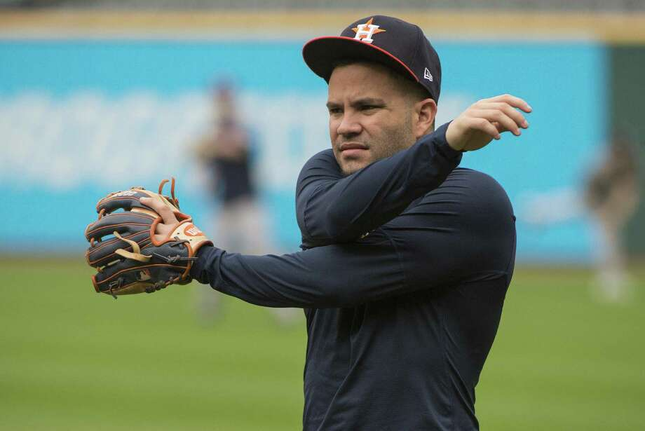 Houston Astros' Jose Altuve stretches during a workout in Cleveland, Sunday. The Astros play the Cleveland Indians in the third game of their ALDS series, Monday. Photo: Phil Long, FRE / Associated Press / Copyright 2018 The Associated Press. All rights reserved.