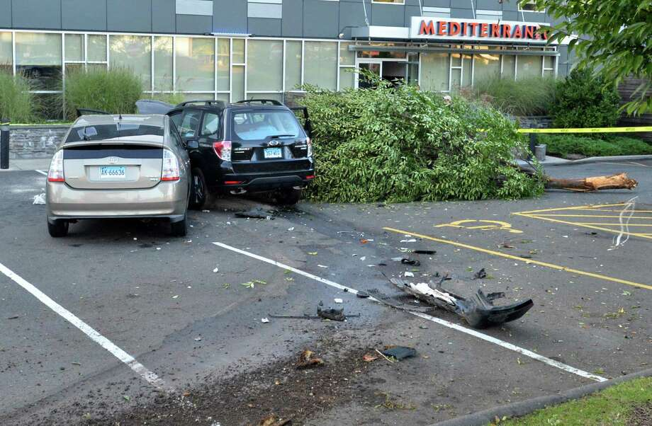 A man was injured after his Subaru crashed into the parking lot of the Hotel Zero Degrees, taking out a tree and a Toyota Prius on Sunday in Norwalk. Photo: Alex Von Kleydorff / Hearst Connecticut Media / Norwalk Hour
