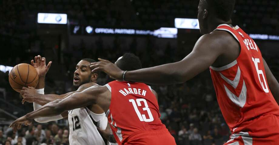 San Antonio Spurs' LaMarcus Aldridge gets pressure from Houston Rockets' James Harden and Clint Capela during the first half at the AT&T Center, Sunday, Oct. 7, 2018. Photo: JERRY LARA/San Antonio Express-News