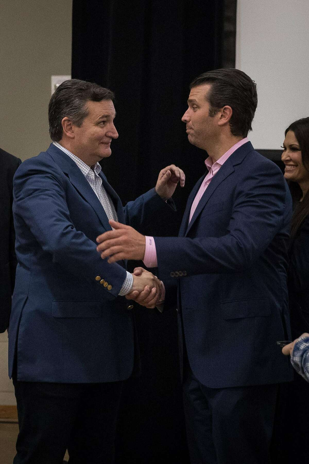 CONROE, TX - OCTOBER 03: U.S. Sen. Ted Cruz (R-TX) shakes hands with Donald Trump Jr. after addressing supporters during a campaign rally on October 3, 2018 in Conroe, Texas. Cruz is in a tight reelection race against Democratic opponent Beto O'Rourke. (Photo by Loren Elliott/Getty Images)