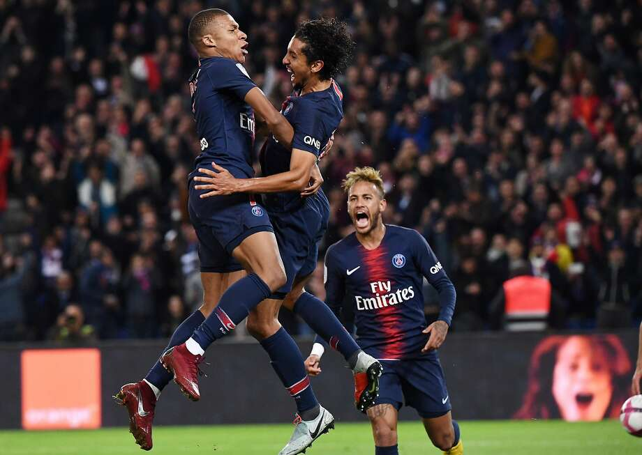 Paris Saint-Germain's Kylian Mbappe (left) is congratulated by Marquinhos and Neymar (right) after scoring one of his four goals against Lyon. Photo: Anne-christine Poujoulat / AFP / Getty Images