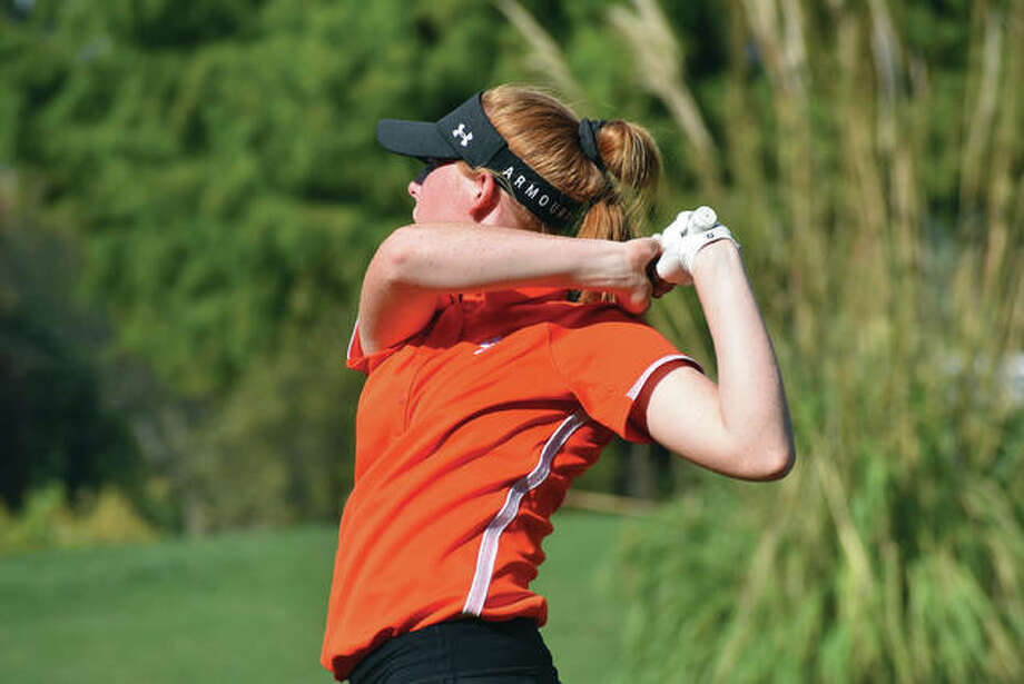 Edwardsville freshman Riley Lewis watches her tee shot on Hole No. 15 at Arlington Greens Golf Course in Granite City during the Class 2A Collinsville Regional. Photo: Matthew Kamp/Intelligencer