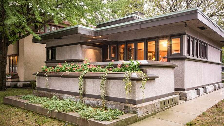 Frank Lloyd Wright's kit homes were designed to promote harmony, connecting family members to one another through shared spaces such as central fireplaces. Photo: Robert Hartmann