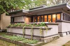 Frank Lloyd Wright's kit homes were designed to promote harmony, connecting family members to one another through shared spaces such as central fireplaces.