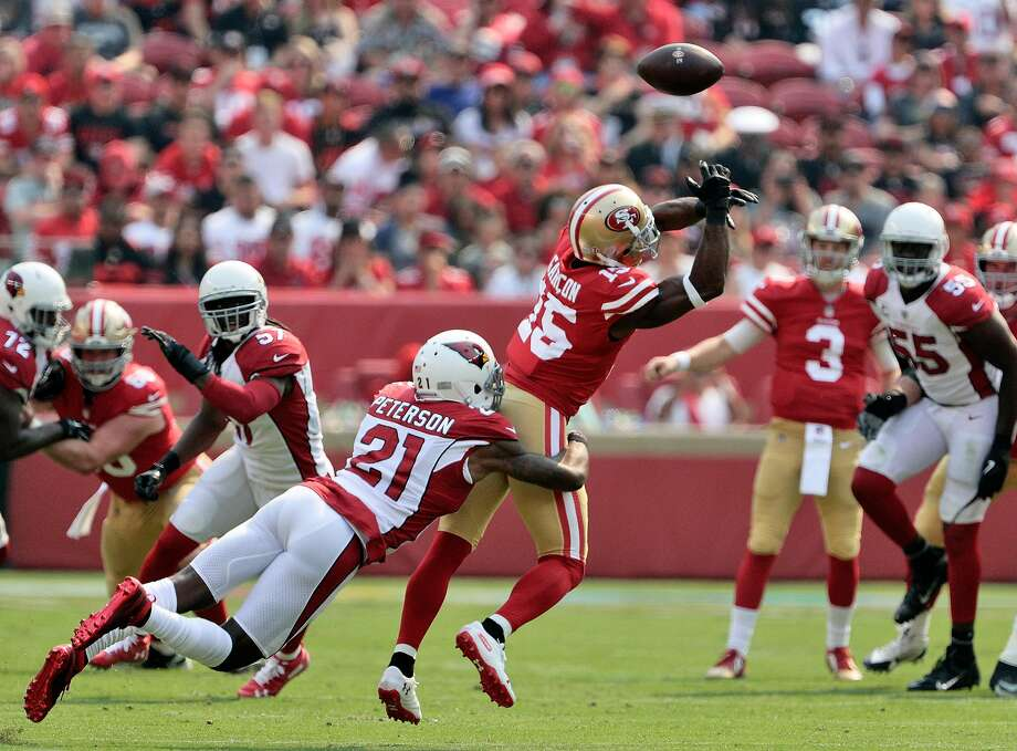 Pierre Garcon (15) tips a pass from C.J. Beathard (3) which was then intercepted by Tre Boston (33) in the first quarter as the San Francisco 49ers played the Arizona Cardinals at Levi's Stadium in Santa Clara, Calif., on Sunday, October 7, 2018. Photo: Carlos Avila Gonzalez / The Chronicle