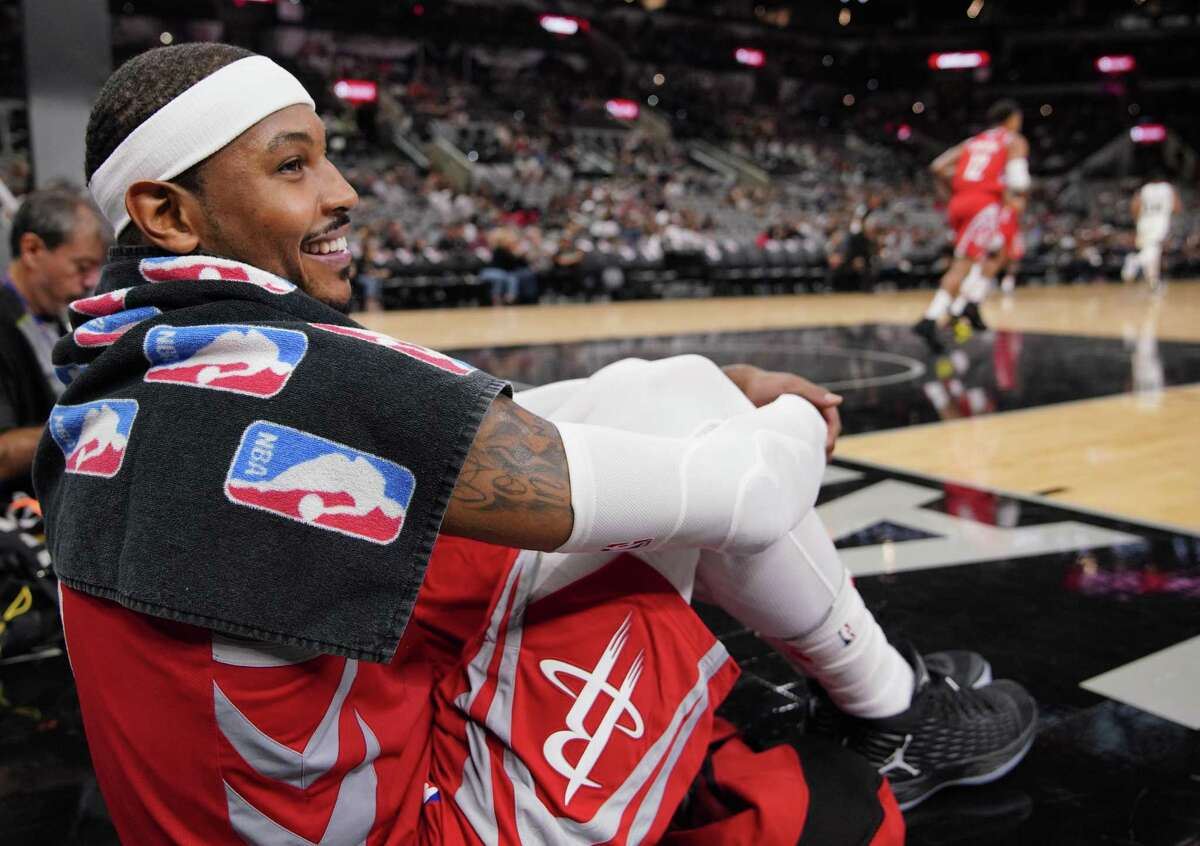 PHOTOS: Everything you need to know about Carmelo Anthony Houston Rockets' Carmelo Anthony watches play from the baseline during the second half of an NBA preseason basketball game against the San Antonio Spurs, Sunday, Oct. 7, 2018, in San Antonio. (AP Photo/Darren Abate)